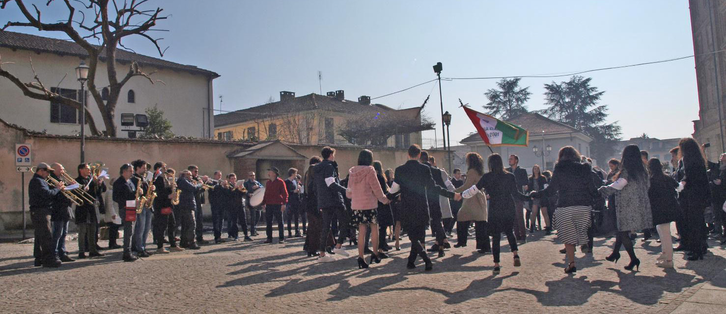 """FIGURE-15.-The-""""conscripts""""-of-2001-dancing-the-brando-in-the-town-square-of-Riva-presso-Chieri,-accompanied-by-the-musicians-of-the-Filarmonica-rivese-(2019)"""