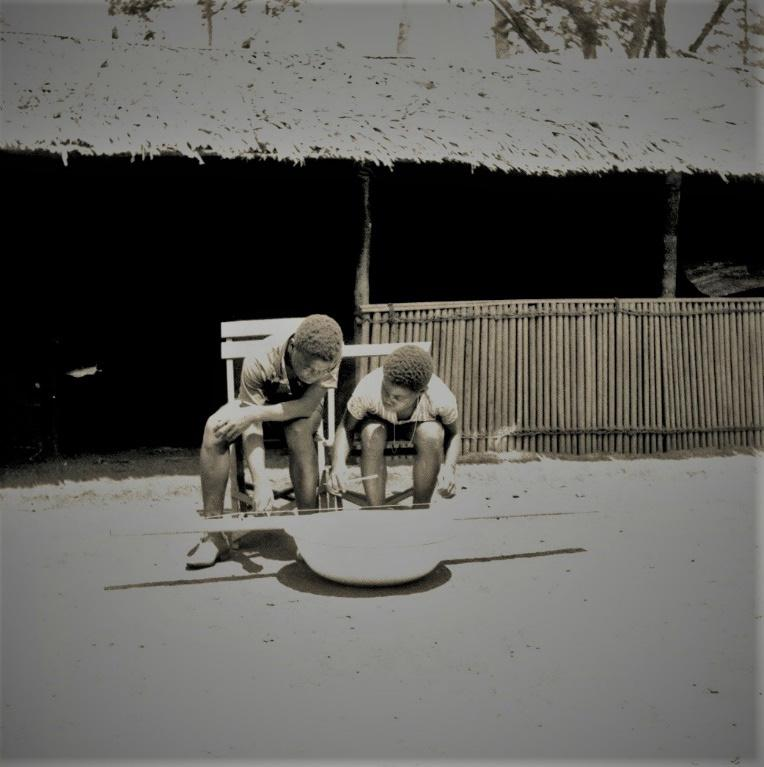 FIGURE 2. Mpeli, monoidiochord zither played by two youngsters_Maurice Djenda and Moise Mbongo in their village